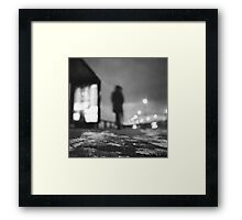 Man waiting at bus stop at night in winter square black and white analogue medium format film Hasselblad  photo Framed Print
