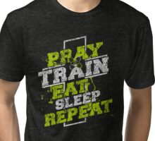 Give praise and train! Tri-blend T-Shirt