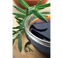 Glass cup with soy sauce and rosemary leaves closeup Photographic Print