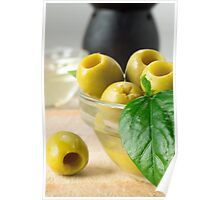 Green marinated olives pitted adorned with green leaves Poster