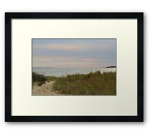 Afternoon setting sun at the beach in autumn Framed Print