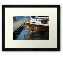 Vintage boat is moored Framed Print