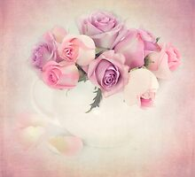 A bouquet of pink and purple roses. by carolynrauh
