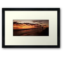 Sunset stroll along the beach Framed Print