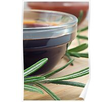 Soy sauce in a glass and a sprig of rosemary Poster