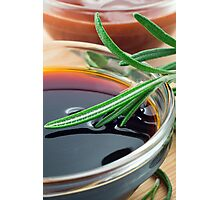 Transparent cup with soy sauce and rosemary leaves close-up Photographic Print