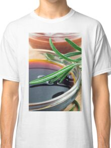 Transparent cup with soy sauce and rosemary leaves close-up Classic T-Shirt