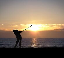 Playing Golf At Sunset by Phil Perkins