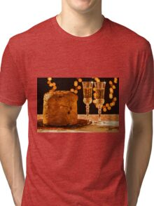 Italian panettone and sparkling wine over a table Tri-blend T-Shirt