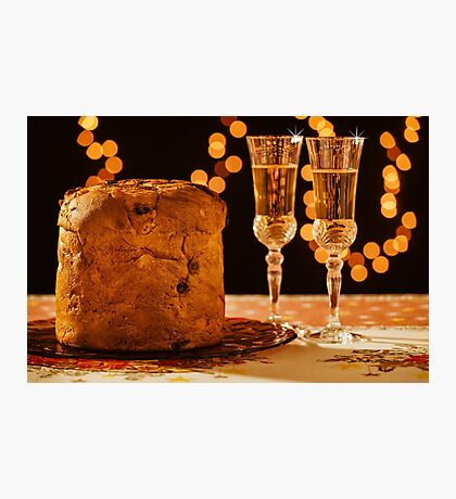 Italian panettone and sparkling wine over a table Photographic Print