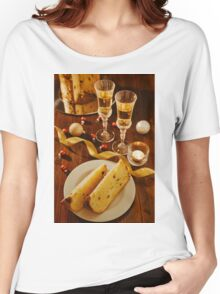 Sliced italian panettone, sparkling wine and decorations over a table Women's Relaxed Fit T-Shirt