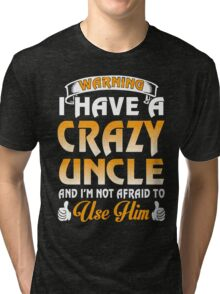 I have a Crazy Uncle xmas shirt Tri-blend T-Shirt