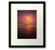 Sunset clouds and long wave Framed Print