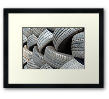 Old car tyres waiting for recycling. Framed Print
