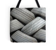 Old car tyres waiting for recycling. Tote Bag