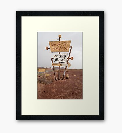 Tall vintage gas sign standing in the desert Framed Print