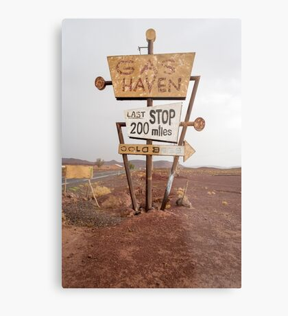 Tall vintage gas sign standing in the desert Metal Print