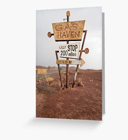 Tall vintage gas sign standing in the desert Greeting Card