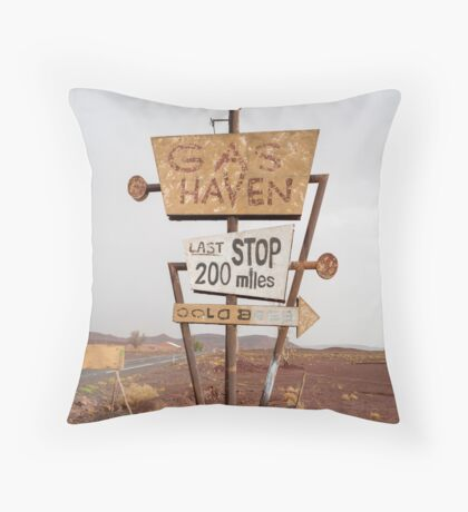 Tall vintage gas sign standing in the desert Throw Pillow