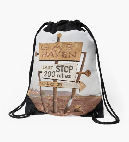 Tall vintage gas sign standing in the desert Drawstring Bag