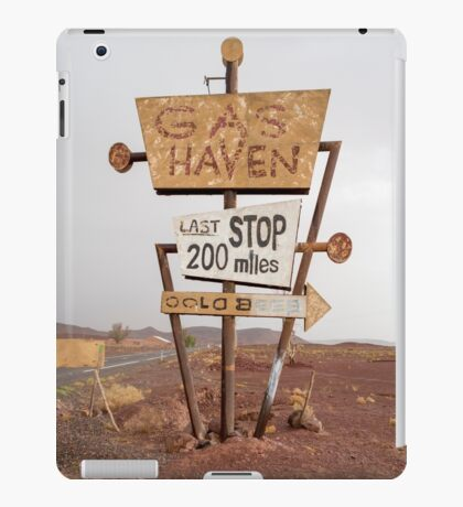 Tall vintage gas sign standing in the desert iPad Case/Skin