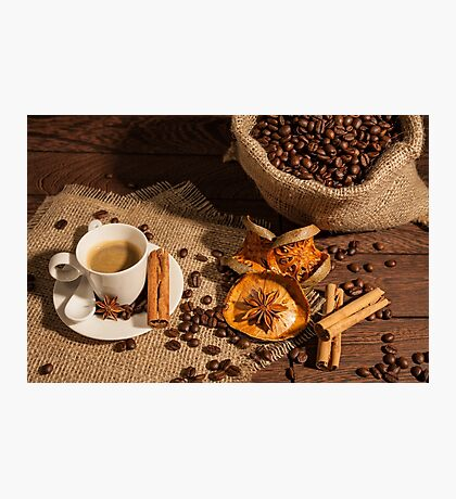 Coffee cup with star anise, cinnamon and dried orange fruit Photographic Print