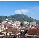 Sapa Vietnam View across the roofs of the town to Ham Rong Mountain. by stuwdamdorp