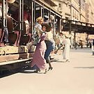 Mother helps her child off trolley in NYC — Colorized by Sanna Dullaway