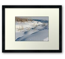 fresh falling snow and little snow drifts with stubble  Framed Print