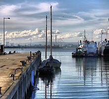 Reflections at Workman's Pier. by Larry Lingard-Davis