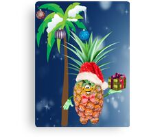Pineapple in red Christmas cap with a gift under a palm tree Canvas Print