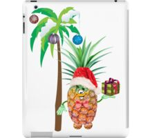 Pineapple in red Christmas cap with a gift under a palm tree iPad Case/Skin
