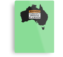 WARNING: CURRENTLY OPERATED BY A MORON Metal Print