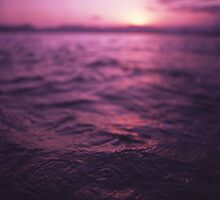Mediterranean sea water off Ibiza Spain in surreal purple sunset evening dusk colors film analog photo by edwardolive
