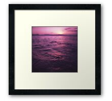 Mediterranean sea water off Ibiza Spain in surreal purple sunset evening dusk colors film analog photo Framed Print