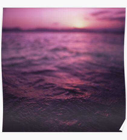 Mediterranean sea water off Ibiza Spain in surreal purple sunset evening dusk colors film analog photo Poster