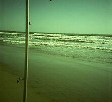 Beach shower in surreal green 35mm xpro cross processed lomographic film lomography analog photo by edwardolive