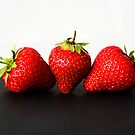 Strawberries on White over Black by Alan Harman