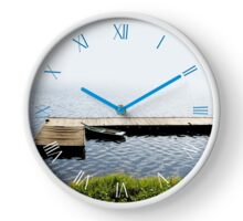 Old dilapidated boat moored Clock