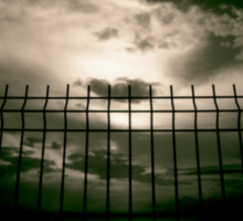 Fence against sky and clouds black and white analog 35mm silver gelatin black and white film photographs Sticker