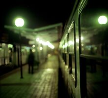 Old train at night in empty station green square Hasselblad medium format film analog photograph by edwardolive