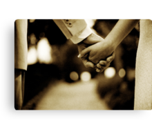 Bride and groom holding hands sepia toned black and white silver gelatin 35mm film analog wedding photograph Canvas Print