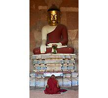 Monk praying to Buddha statue in Bagan Photographic Print