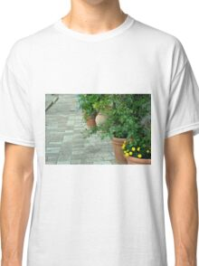 Plants in flower pots on the pavement Classic T-Shirt