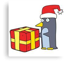 cartoon christmas penguin with present Canvas Print