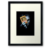 Joker holding up Pokemon Charizard card Framed Print