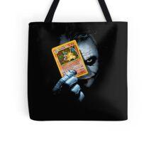 Joker holding up Pokemon Charizard card Tote Bag