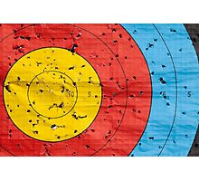 Archery target close up with many arrow holes in  Photographic Print