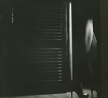 Film noir light through door young lady in heels black and white silver gelatin square analog photo by edwardolive