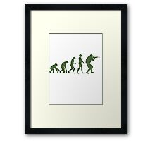 Evolution of ape to airsofter Framed Print